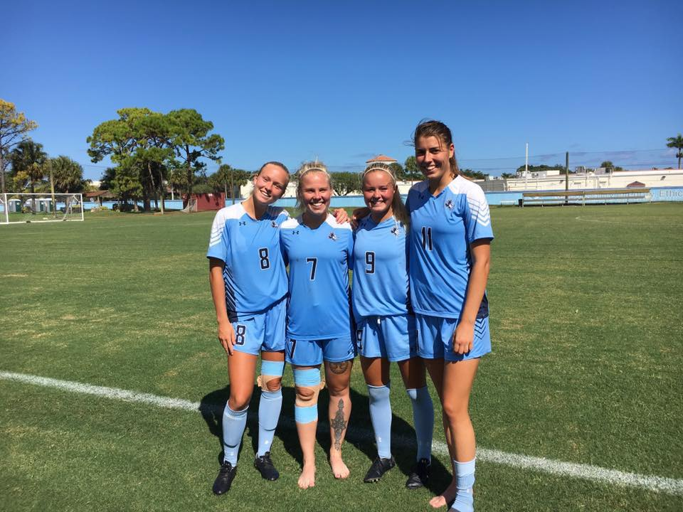 Maxi Krug with 3 members of her college soccer team at Keiser University